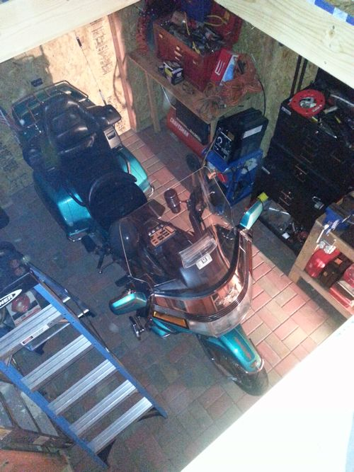 top view of Mikes motorcycle in his shed