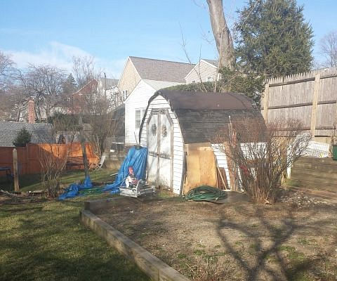 An old shed that is going to be replaced with a 12x12 shed with loft.