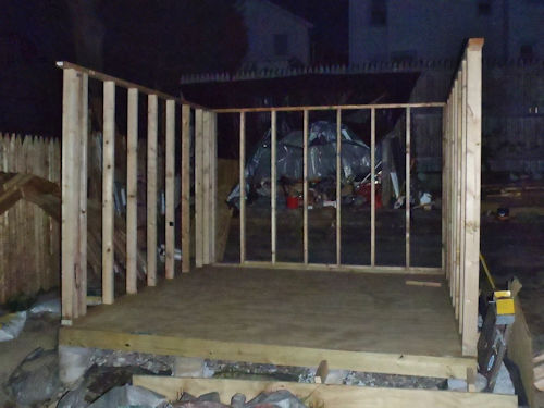 Framing the shed walls for the 12x12 shed with loft.
