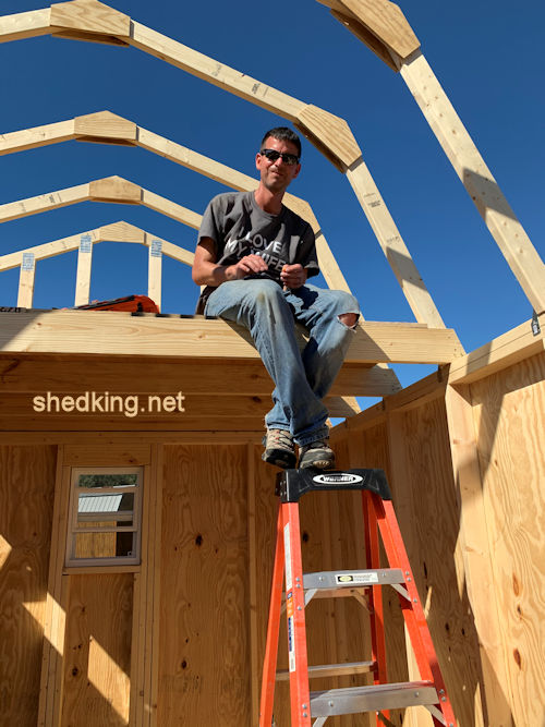 Picture of Dan with his 10x12 barn shed sitting in loft