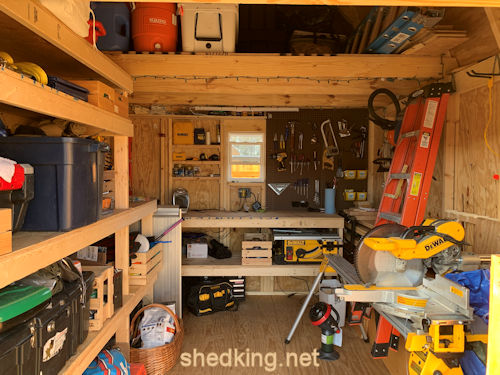 Great picture of Dan's neat storage and workshop setup in his 10x12 barn shed