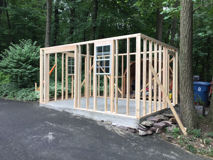 All four shed walls up and nailed into place.