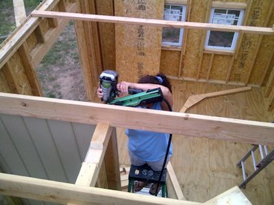 Wife using a framing nailer