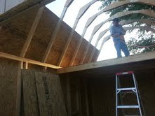 Sheeting the roof before adding roof sheeting to the barn shed.