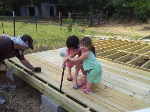 Davids daughters helpling him build his barn shed