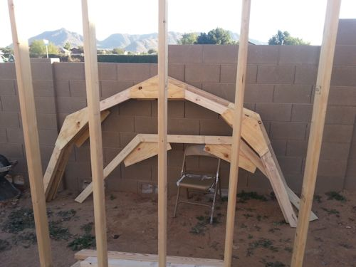 trusses built and ready to go up on the playhouse shed