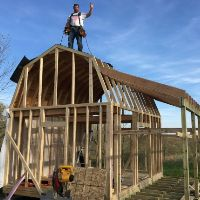 Pictures of Tim Framing his shed with porch for off grid cabin.
